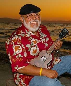 Pat playing the uke by the seashore