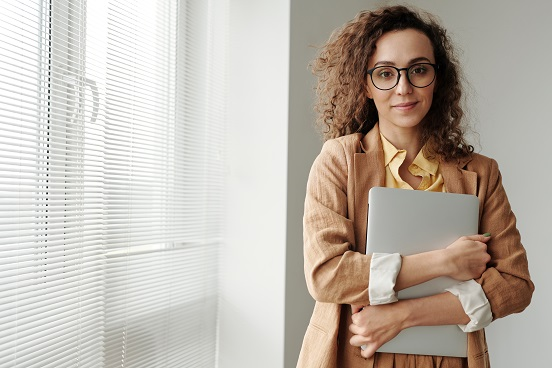 Professional woman holding laptop